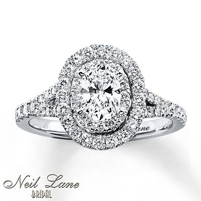 Two rows of round diamonds frame a captivating oval diamond in this engagement ring from the Neil Lane Bridal® collection. Additional round diamonds grace the band to complete the look. The 14K white gold ring has a total diamond weight of 1 carat. Neil Lane's signature appears on the inside of the band. Diamond Total Carat Weight may range from .95 - 1.11 carats.