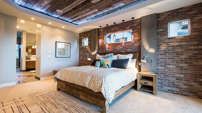 Для того чтобы сохранить основную функцию спальни — отдых, натуральная кирпичная стена подходит идеально.