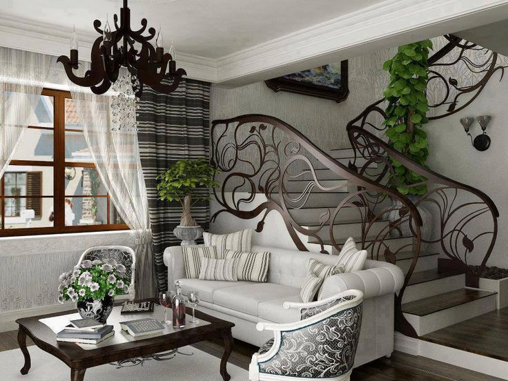 This Room Shows The Art Nouveau Style Of Interior Design Uniquely Shaped Stair Railschandelier And Unusual Pillar Surrounded By Decorative Vines