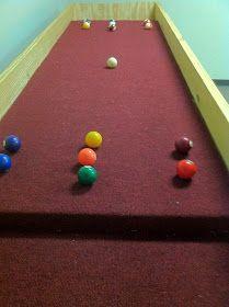 Carpet ball or gutter ball table