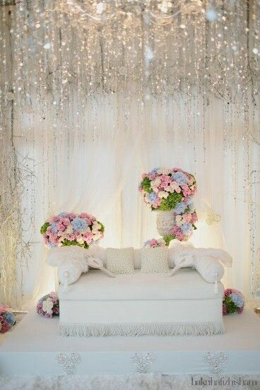 White pelamin with light pink and blue accents