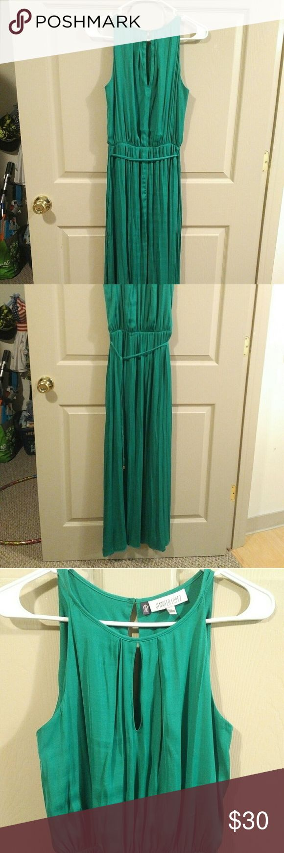 Long, green dress. Dressy or casual! Green silky dress with eyelet opening at neckline. Dress up with heels or wear casually with sandals. Worn one time. Jennifer Lopez Dresses Maxi