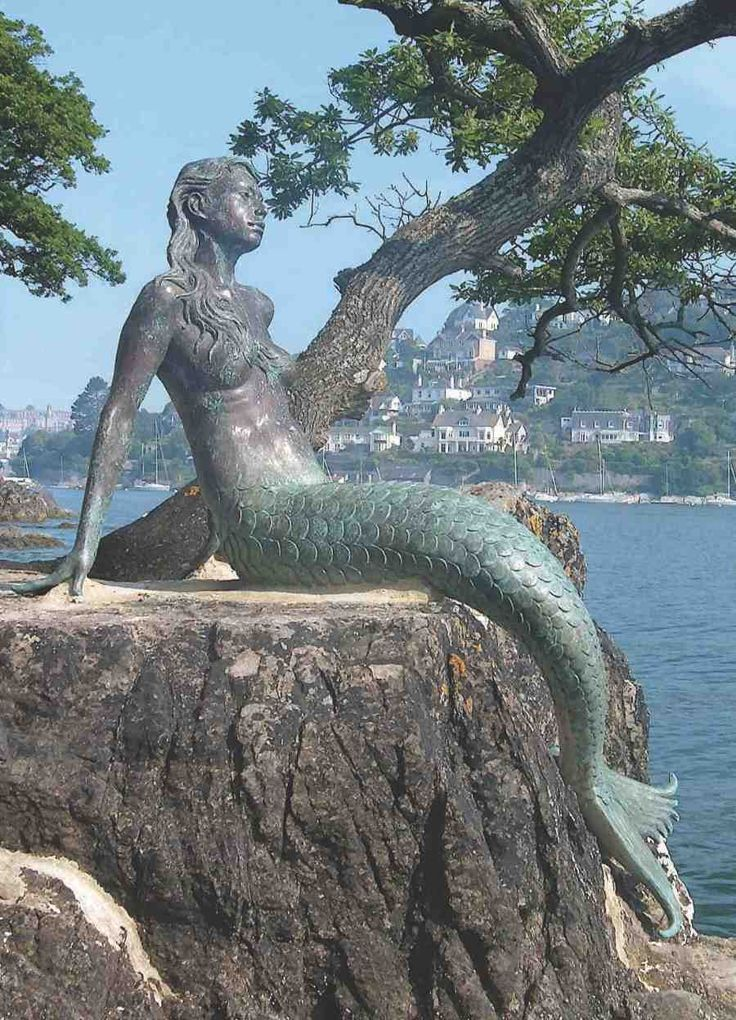 Like her owner, Dartmouth's striking mermaid Miranda has a dramatic view from her home, perched on a rocky peninsula on the banks of the River Dart.