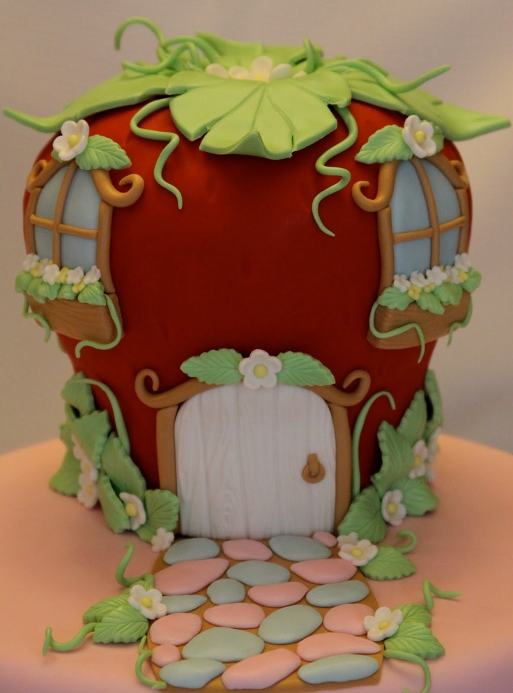Strawberry Shortcake's House Cake.  Would have been perfect for Isa's last birthday :)  Why do I find these cool things after the fact lol