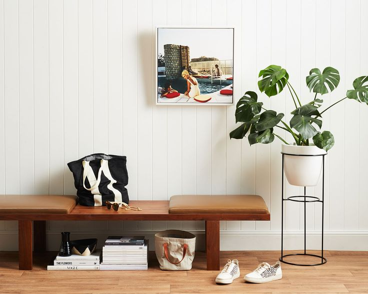 Paired Back Cool: This minimal entry is low key cool, get a furniture piece like our Muller Bench that can do it all; tidy away shoes, stack books and throw your keys on it. Then just add art and greenery for an easy hallway update.