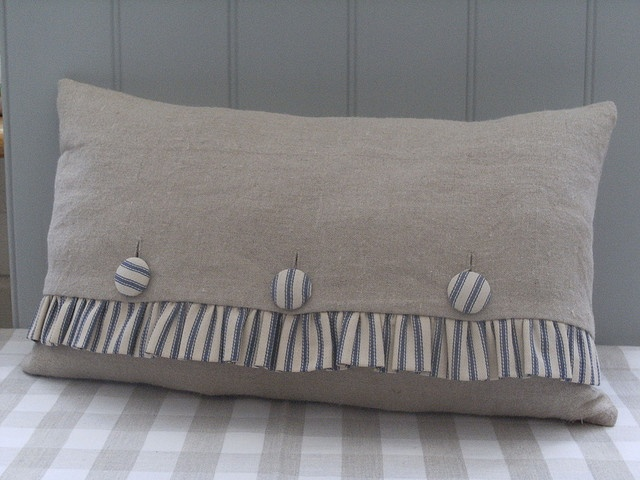 Burlap Pillow/ ticking stripe so sweet with ruffle. I would make the ruffle using a Texas theme and use stars for the buttons.