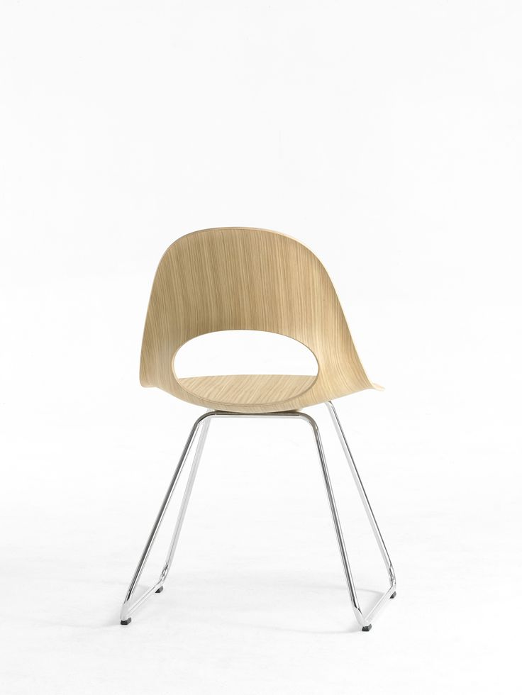This beautiful SayO MiniLux Chair in raw wood with metal legs seen from behind. May be acquired with different types of wood veneer. Find out more at www.sayo.dk.