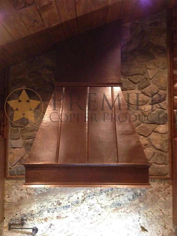 This Copper Range Hood Is Perfectly Set Off By The Stone