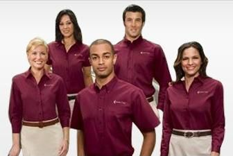 Spa staff wearing a simple look with maroon shirts with for Uniform for spa staff