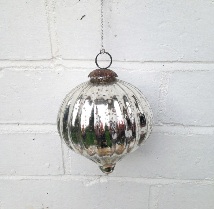 Large silver glass baubles will look perfect any any Christmas tree. This item has been produced by Noah's Ark International, a WFTO organisation in India.