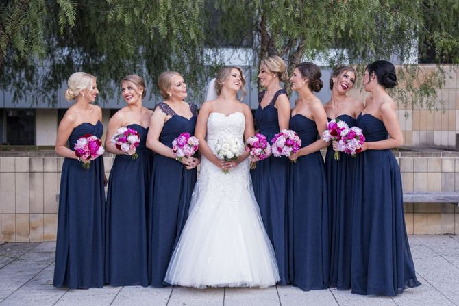 A gorgeous pop of colour with pink flowers and navy bridesmaid dresses #markjayphotography #sydneyweddingphotographer #weddingphotography #flowers #bridesmaid #bride