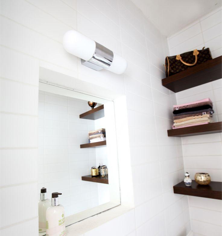 Modern White round shaped wall lamp Skina for bathrooms from Sessak. Chromed metal and white glass.