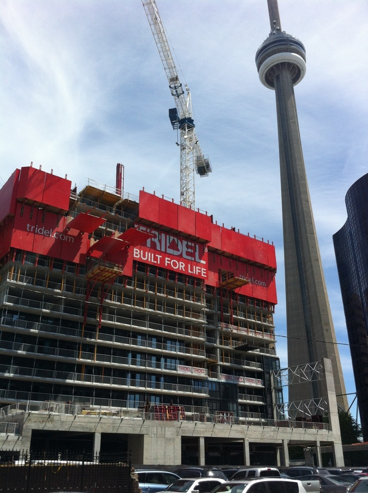 The CN tower makes a great backdrop for 300 Front Street West condos in Toronto.