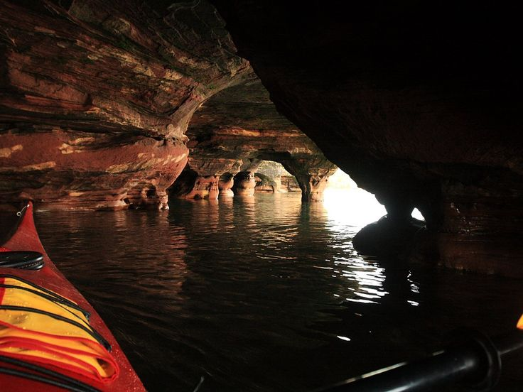 Kayak through the Apostle Islands, off the Wisconsin shore of Lake Superior. The group of 22 islands is riddled with caves, and during the w...