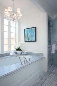 Full slab Carrara marble tub deck.  Ogee edge detail.  Undermount bathtub.  Carrara marble brick patterned floor & basket weave.