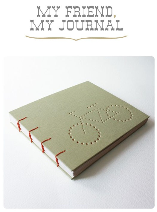 green coptic stitch handmade book with bicycle imprint