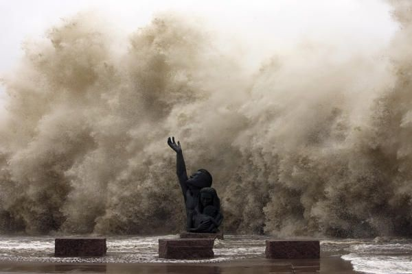 This amazing photo shows waves breaking over the seawall, where there is a memorial to those who died in the terrible hurricane in 1900.