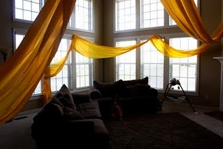 use yellow table cover to decorate for Rapunzel's hair. (100ft roll of table coverings)
