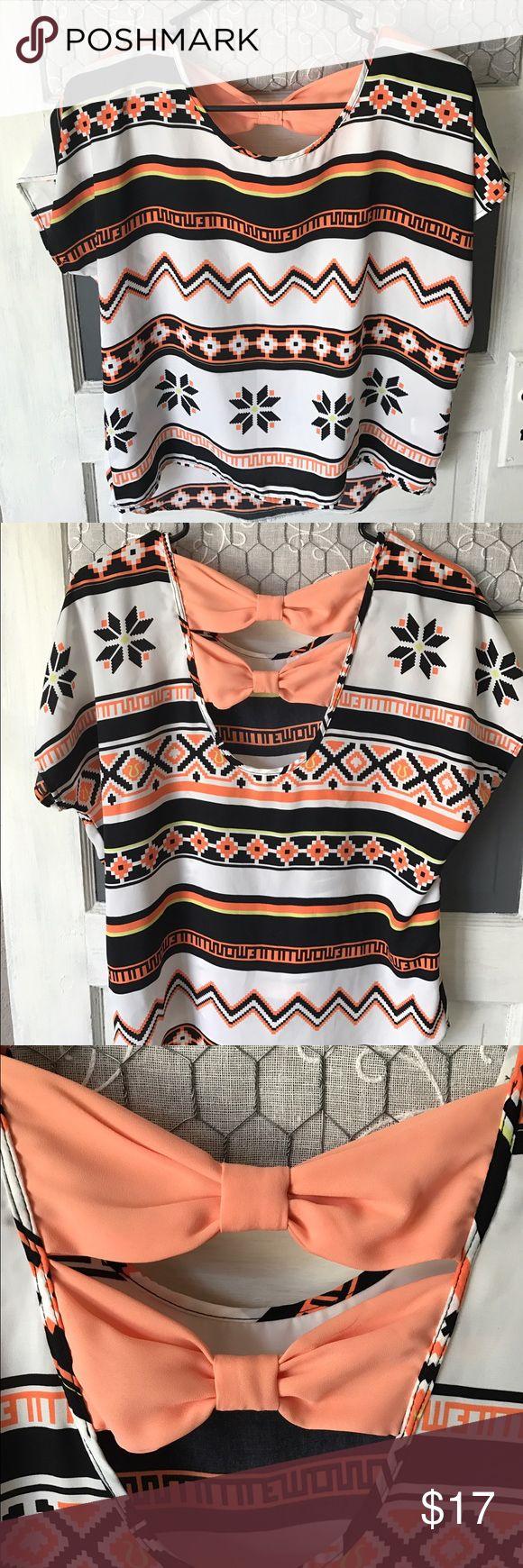 Aztec Blouse/Shirt, bow back Cute Blouse with Aztec design. Never worn! Tops Blouses