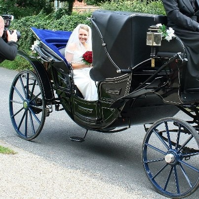 Just the right size for a casual ride in a small kingdom. Wedding landau c/o The Ostler.org.uk.
