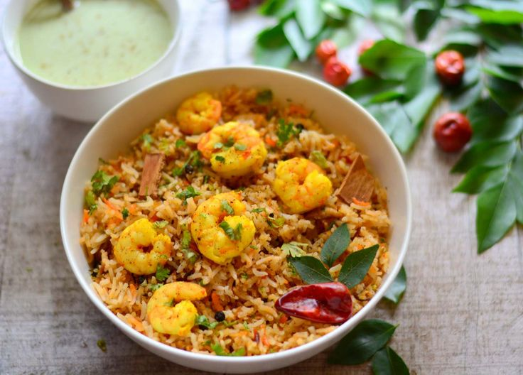 Make your weekend lunch special with Chettinad Style Prawn Biryani. It's a South Indian version that is cooked with assorted spices and given the authentic Chettinad flavors by a wide usage of shallots black pepper and coconut. Chettinad of cooking is an integral part of South Indian Cuisine.  Recipe Link -> http://ift.tt/2jJRtQp #Vegetarian #Recipes