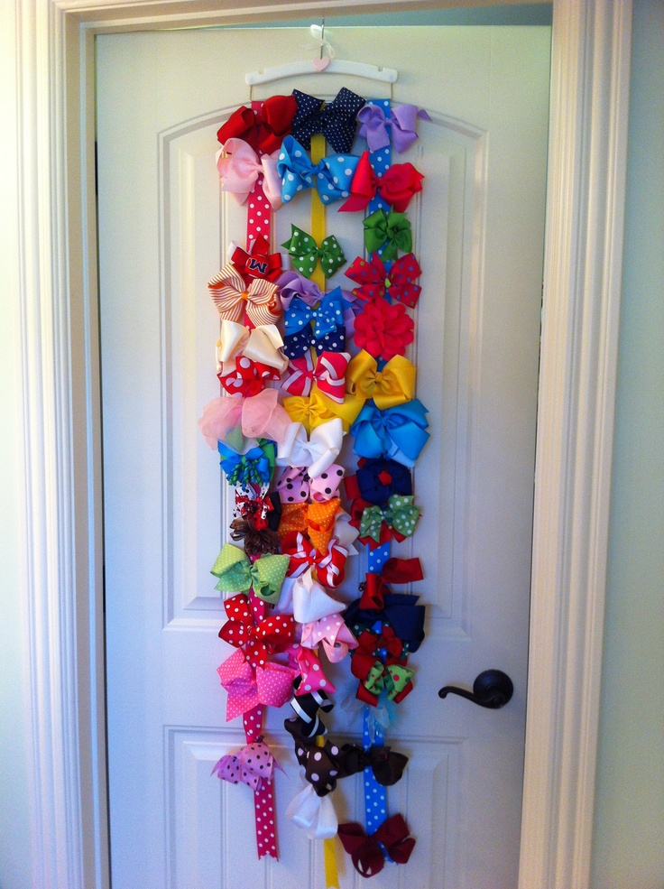Hair bow storage - cute hanger and some ribbon. Presto! A custom length hair bow storage solution:).