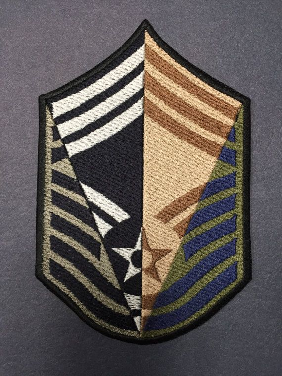 THE PERFECT ITEM FOR YOUR MILITARY SHADOW BOX!!! This custom-made Air Force Chief Master Sergeant (CMSgt) chevron combines all the colors of the stripes worn by Air Force members into one unique chevron. All Air Force uniforms are represented: ABUs, BDUs, DCUs, and Blues.  This product makes an awesome retirement gift and looks great in a shadow box, framed, mounted, or sewn onto a decorative item.  Display your long and distinguished Air Force career proudly with this one-of-a-kind chevron…