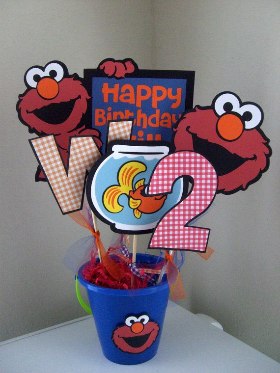 Hey, I found this really awesome Etsy listing at http://www.etsy.com/listing/92980305/elmo-centerpiece-pick-your-colors-boy