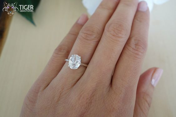 2 Carat Oval Cut Engagement Ring, 4 Prong, Man Made Diamond Simulant, Wedding, Promise Ring, Bridal, Birthstone, Sterling Silver or 14k Gold by TigerGemstones on Etsy www.etsy.com/…