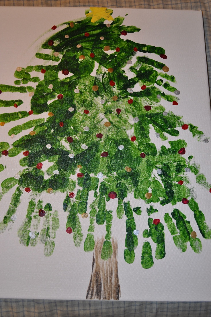 Handprint Christmas tree - did this for my daughter's first birthday. All the grandparents, aunts, uncles and cousins were present.  Her hand is at the top.