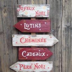 Décoration de noël panneau de direction avec flèches en bois de palette