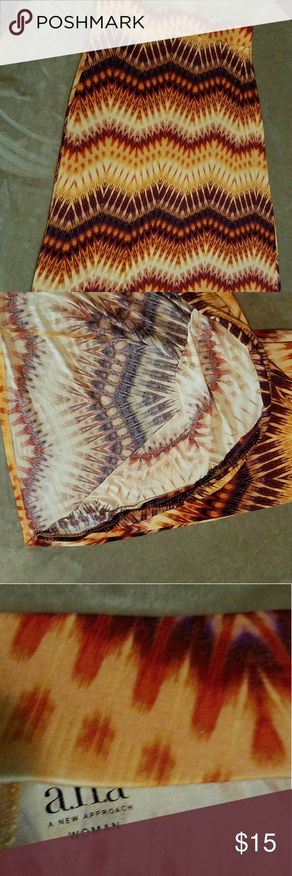 Ana maxi skirt size 1x Plus size maxi skirt with an Aztec design. The colors are orange, pinkish red, purple and cream. It went very well with an orange tank top. Barely worn due to weight loss (Not bragging,  just explaining ??). Very comfortable and pretty for spring and summer. ana Dresses Maxi