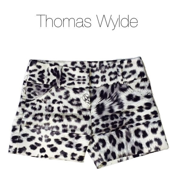 NWOT Thomas Wylde Silk Leopard Print Shorts Black, white and gray shorts by Thomas Wylde. 100% silk. Leopard print featuring signature Thomas Wylde skulls. Wide waistband featuring five belt loops. Side pockets. Fly front with hook-and-eye fastening. Wide cuffs. Thomas Wylde Shorts