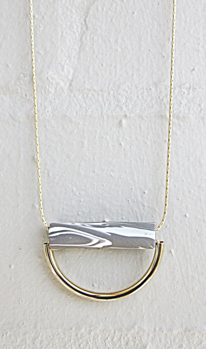 Grey and white marble polymer clay bead with gold plated curved tube pendant on gold plated brass chain by Dolly and Romeo #foundonfelt #aklfair #newzealandmade #pinandwin