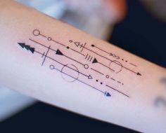 Ornamental style arrows on the left forearm.