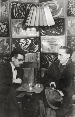 Man Ray and Marcel Duchamp Playing Chess in Man Ray's Studio at 2 Bis, Rue Ferou, Paris, 1960 -by Man Ray