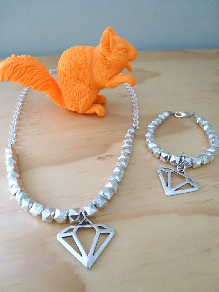 Penny Foggo NZ - check out her website! pennyfoggo.co.nz  Large metal diamond shape on a bracelet threaded with metal geometric beads. Average bracelet length 20cm.