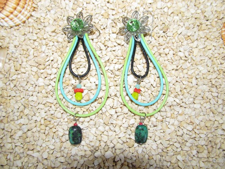 Handmade earrings (1 pair)  Made with leather cords, metal flowers, gemstones and glass beads.