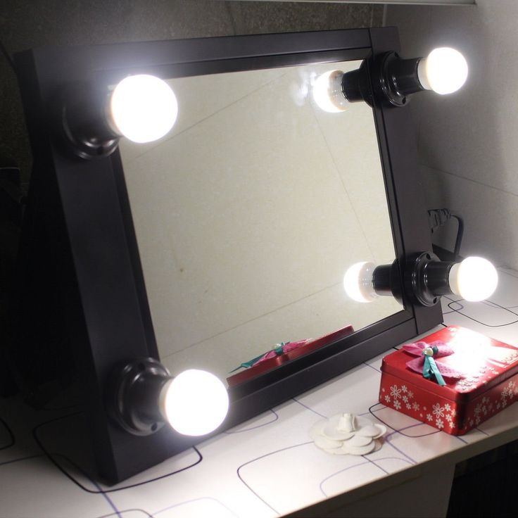Black Portable Vanity Mirror with Light Bulbs Hollywood Style Girl lighted Makeup Mirror, Professional Glow Beauty Mirror for Bedroom, Free LED Bulbs, Gifts for Women (Black). FREE 5 LED bulbs. Folding mirror, Easy to use and take. Aluminum frame, Vanity mirror. Size: 7.71'' x 12.59'' x 1.18''. Package: 1 x vanity mirror, 1 x power cord and 5 x LED bulbs.