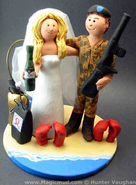 Shopaholic Bride Cake Topper    Soldier in Camouflage Wedding Cake Topper custom created for you! Perfect for the marriage of a Army Marine Groom in Camouflage Uniform and his Bride!    $235   #magicmud   1 800 231 9814   www.magicmud.com