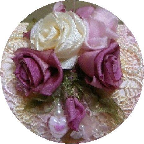 Folded Ribbon Roses embellishing Lace Pillow