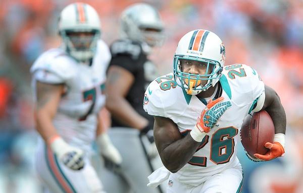 Miami running back Lamar Miller heads upfield on a fourth quarter touchdown run.