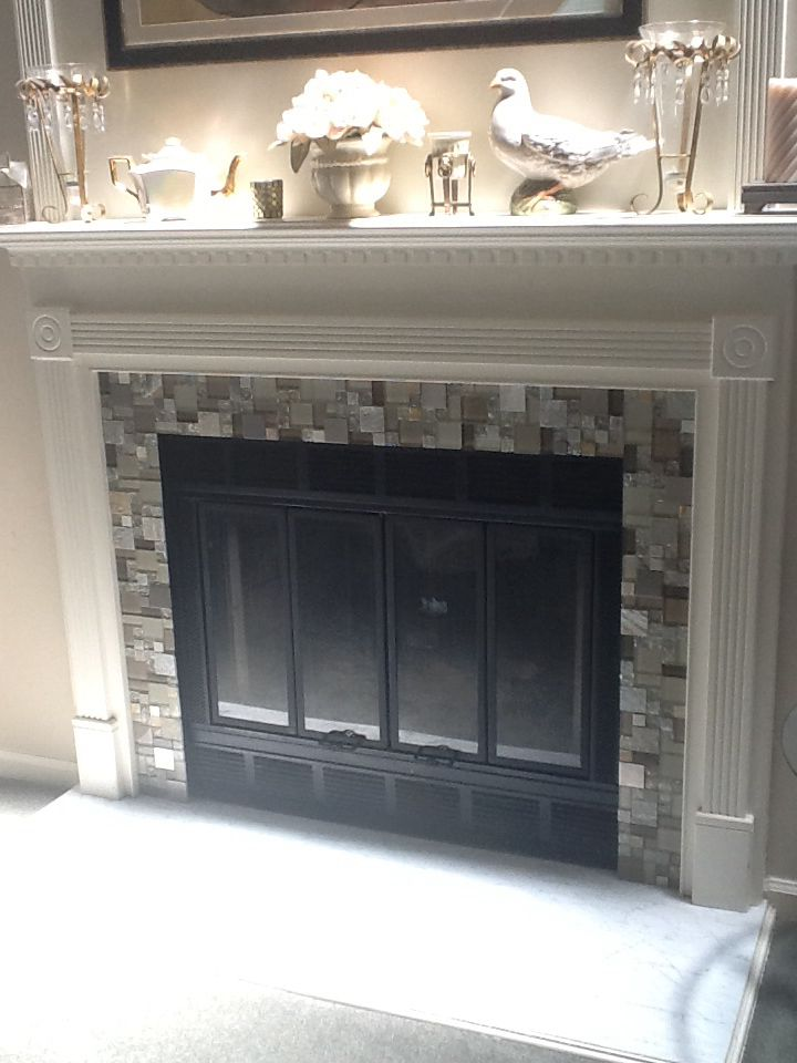 Glass Tile Fireplace done over existing marble surround. Used mirror adhesive. So easy!