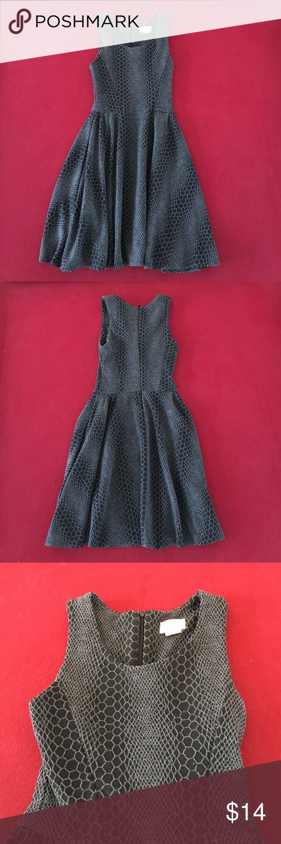 Snakeskin Design Skater Dress Women's skater dress with a snakeskin design. This dress is in excellent condition and has a zipper closure in the back. It is dry clean only. Dresses Mini