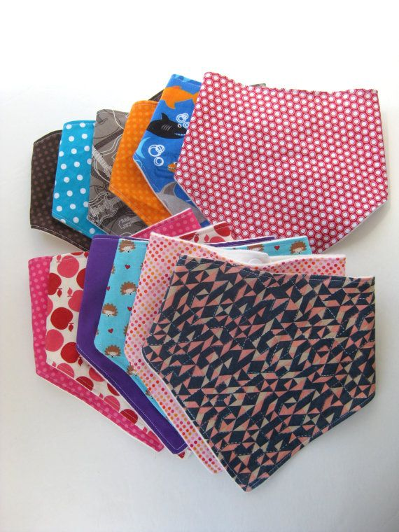 Cute baby to toddler Bandana Bibs. Bright fabrics and organic backing, keep your baby in style and their shirt dry!  Great baby gift.