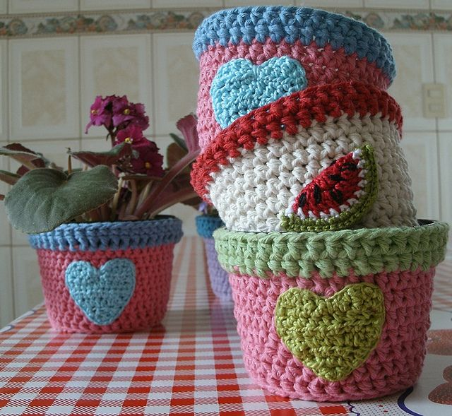 I adore these plant pot covers! I couldn't find the exact page with this picture on it, but I did find a page with the same covers on it.