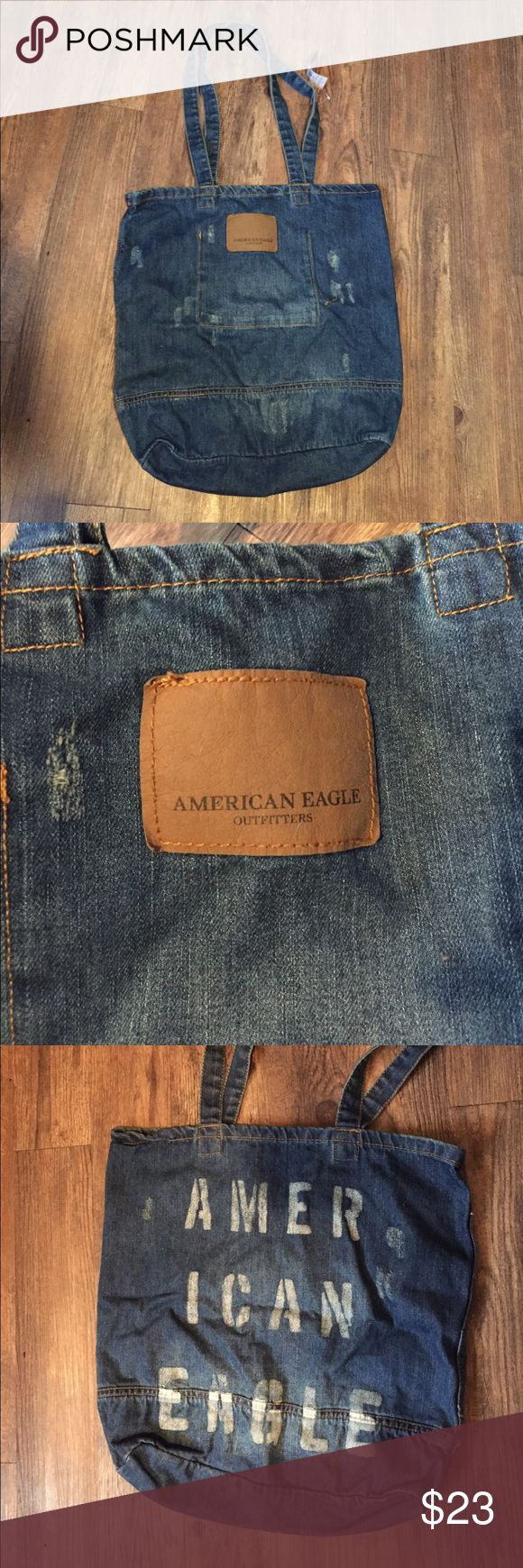 """American Eagle Denim Distressed Tote Bag Laptop New with tags American Eagle denim tote bag. Distressed with a """"leather"""" logo patch on the front and """"AMERICAN EAGLE"""" printed on the back. This bag features a pocket on the inside. Perfect for a laptop, school, or a casual purse! American Eagle Outfitters Bags Totes"""