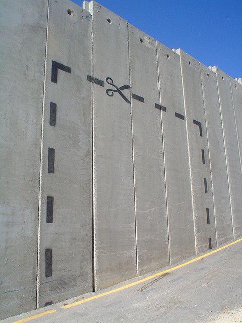 Cut along the line...   by bansky - photo by marneri, via Flickr;  in Bethlehem, West Bank, Palestine