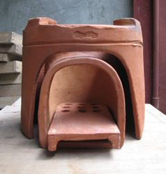 An eco-KALAN is a portable stove made of clay consisting of three components: the outer shell (kalan) on which the cooking pot sits; the inner chamber (rocket elbow) where the combustion takes place; and a shelf with air holes to hold the fuel. The space between the kalan and the combustion chamber is filled with wood ash for insulation.