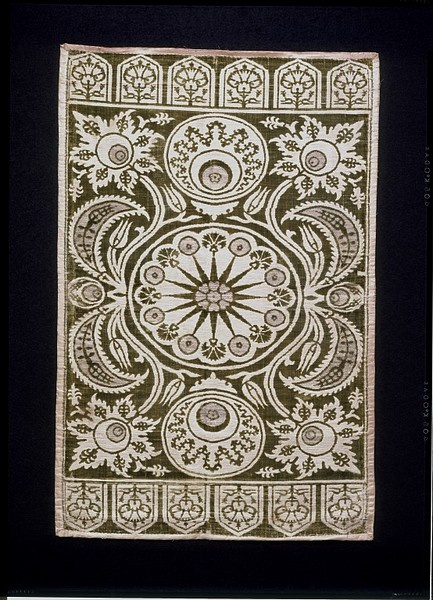 Cushion cover  Place of origin: Turkey  Date:1625-50  Materials and Techniques: Woven silk brocade velvet with vertical and horizontal point repeat with 4 minimum pattern areas.  Museum number:620-1892